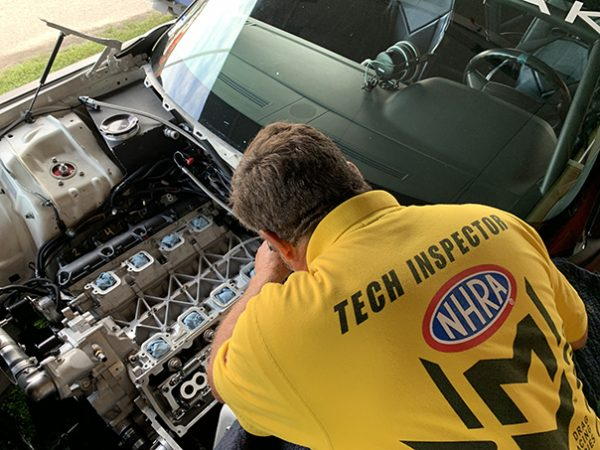 tech inspector observing a vehicle