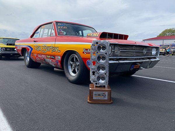 hemi challenge trophy next to a dodge vehicle
