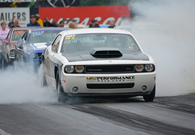 dodge vehicle on the starting line of a drag strip