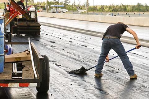 Man working on a drag strip