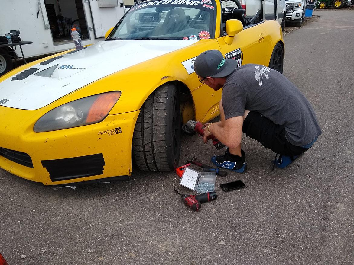 man working on vehicle wheel