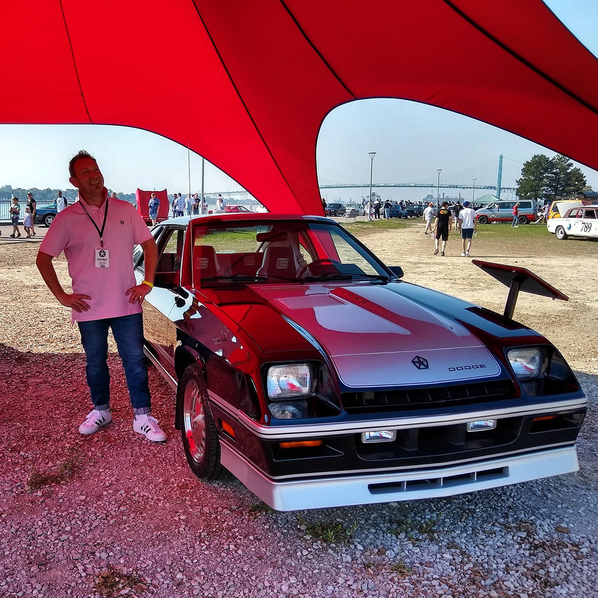 man with a 1995 Dodge Shelby Charger