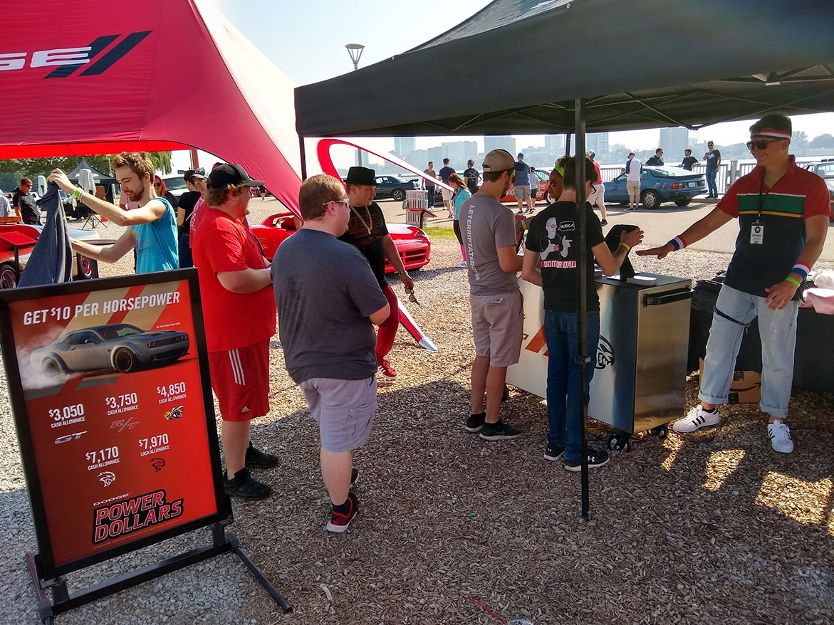 people engaging with the dodge brand display
