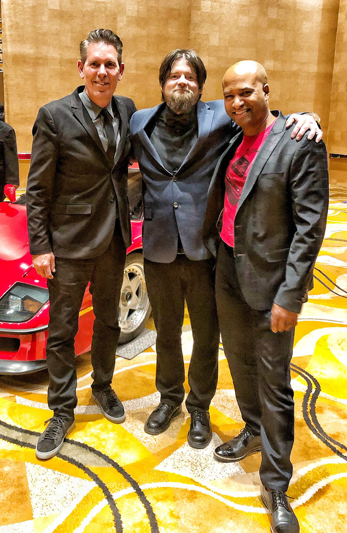 Three men standing together