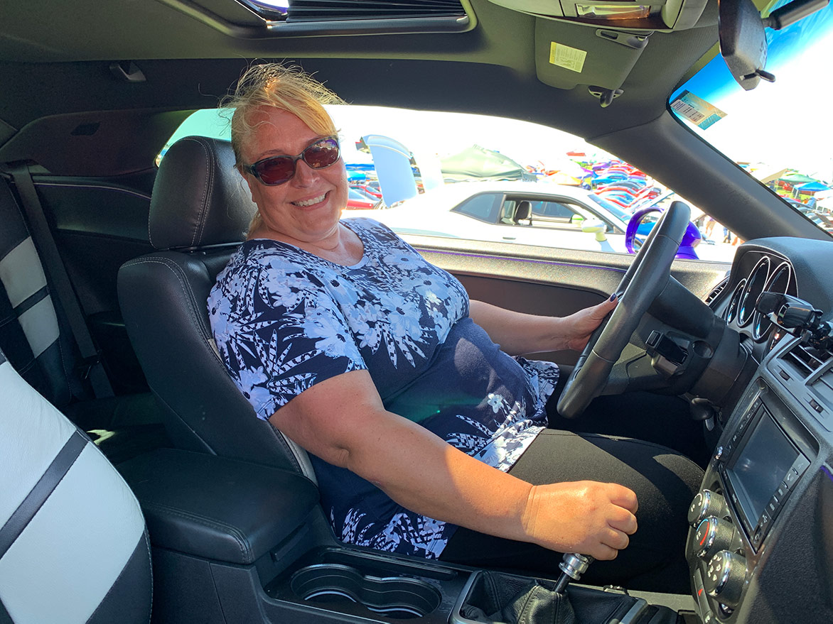 woman in the driver's seat of her dodge vehicle