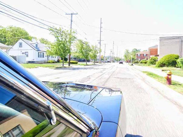 dodge vehicle driving down road