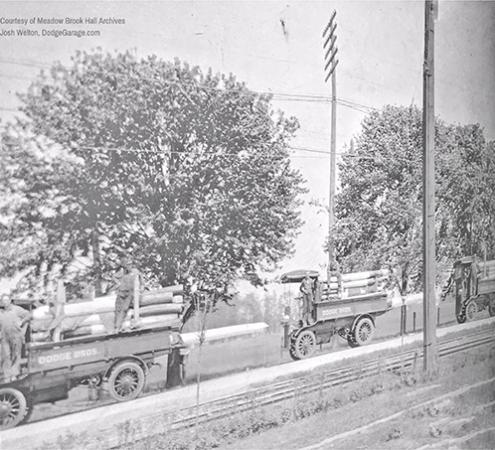 Convoy of trucks transporting 155mm barrels