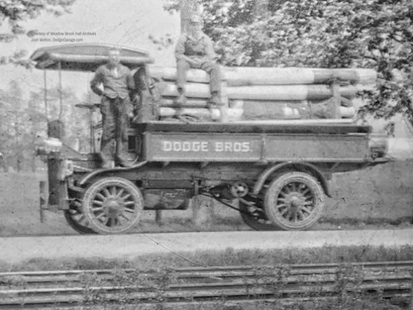 Dodge truck transporting 155mm barrels