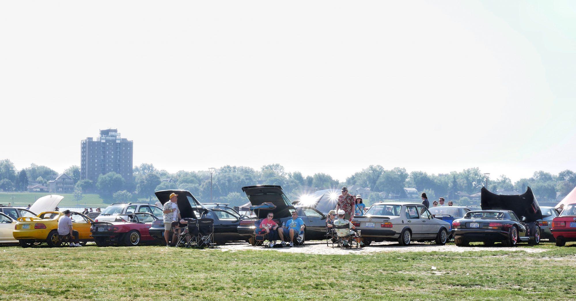people viewing cars on display