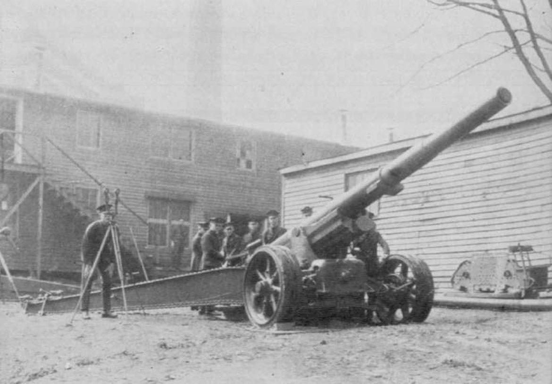 men standing around cannon