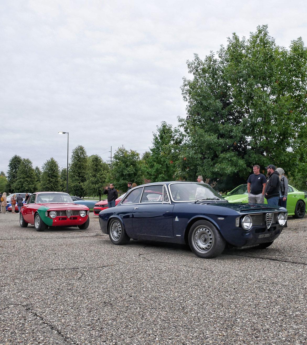 people looking at dodge vehicles on display