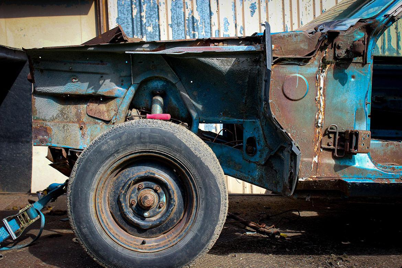 decrepit plymouth vehicle wheel