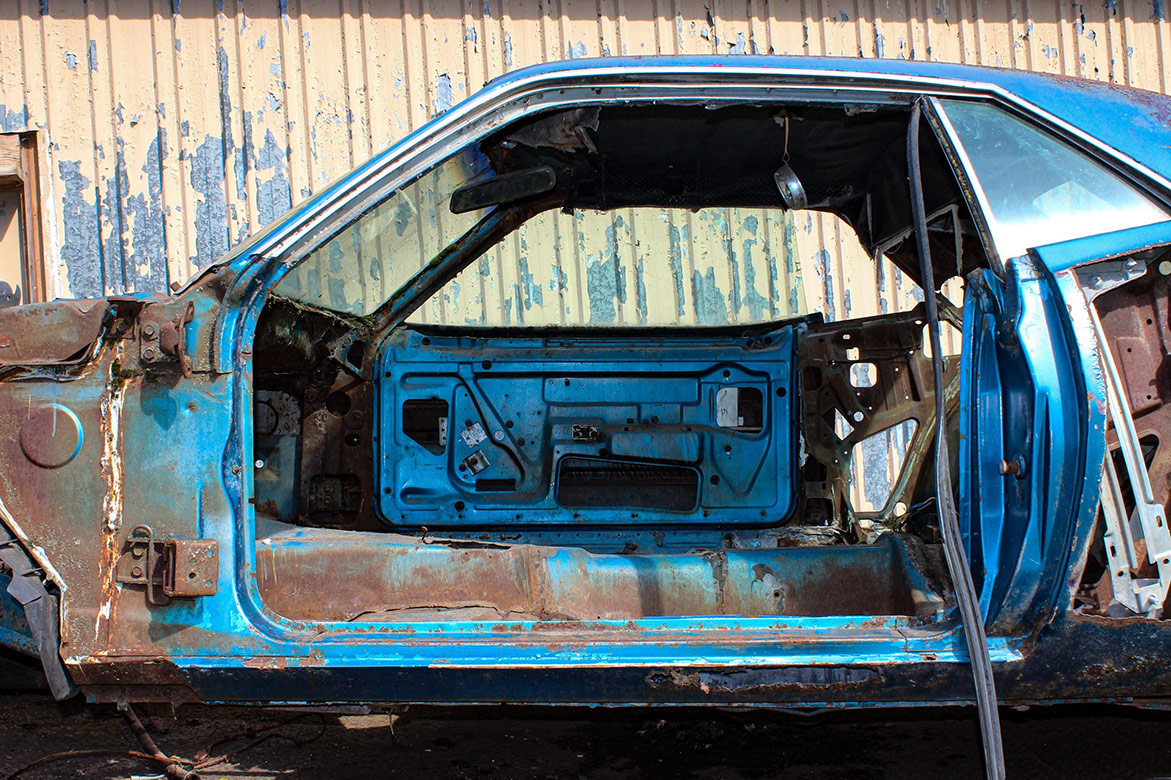 decrepit plymouth vehicle body