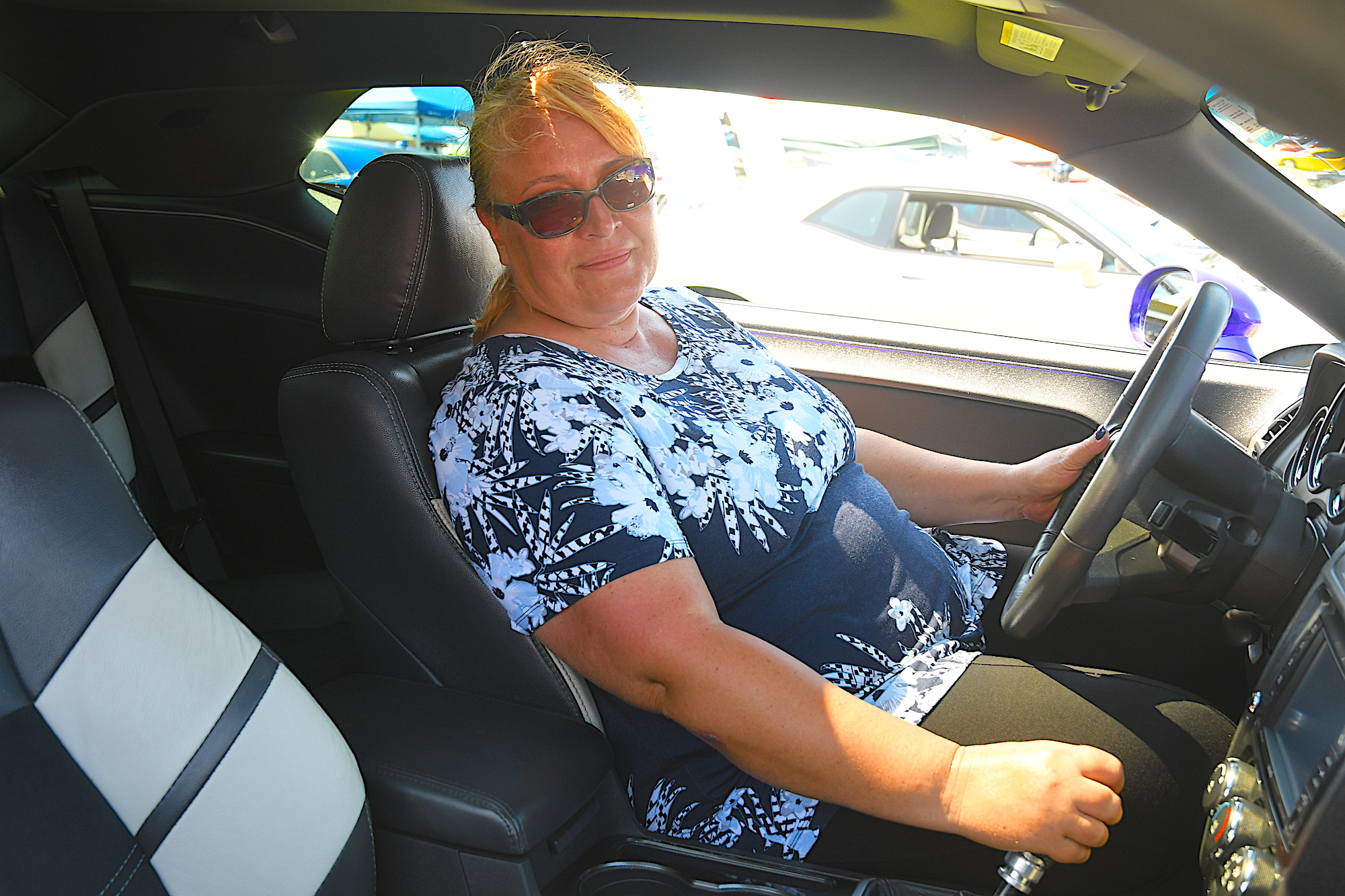 woman sitting inside her dodge vehicle