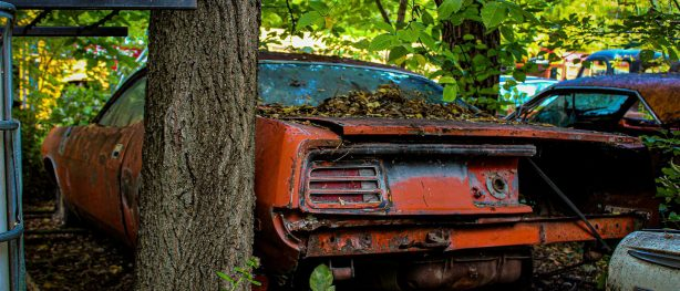 decrepit plymouth vehicle