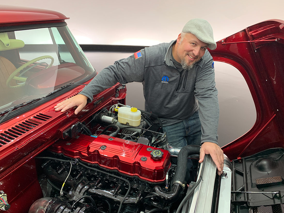 man showing the engine of the Mopar® Dodge Lowliner Concept