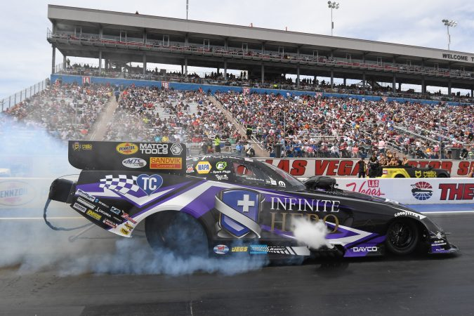 funny car doing a burnout on the drag strip