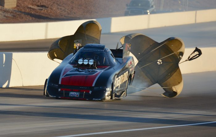 parachutes coming out of a funny car