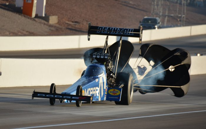 parachutes coming out of a top fuel dragster