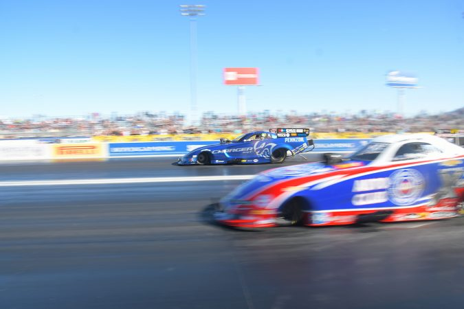 two funny cars coming off the starting line