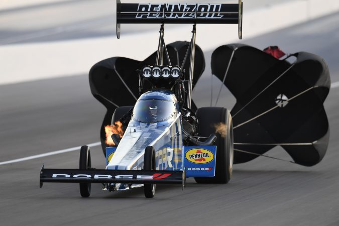 top fuel dragster with parachutes