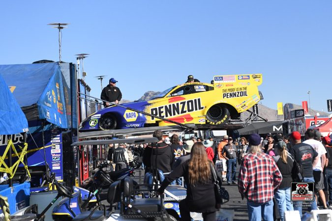 funny car being lifted out of a trailer