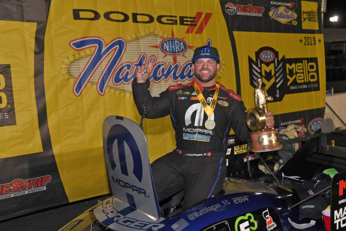 matt hagan holding a wally trophy