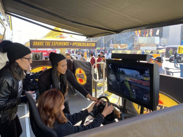 woman playing a pennzoil driving game