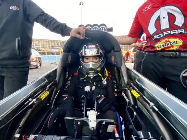 leah pritchett sitting in her top fuel dragster