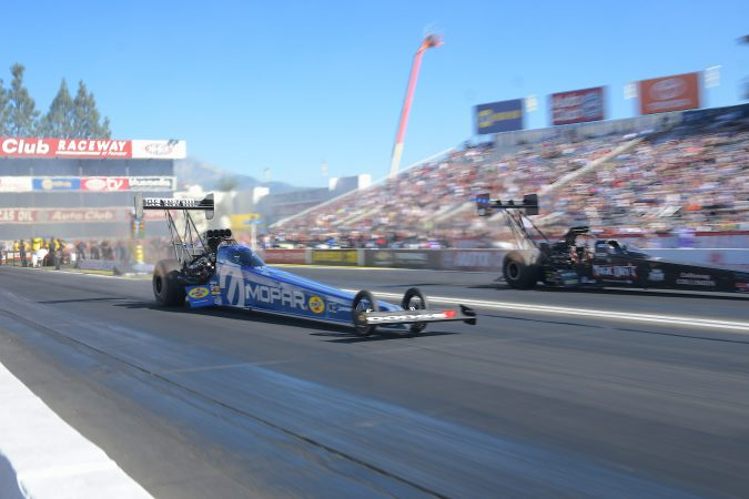top fuel dragster on the drag strip