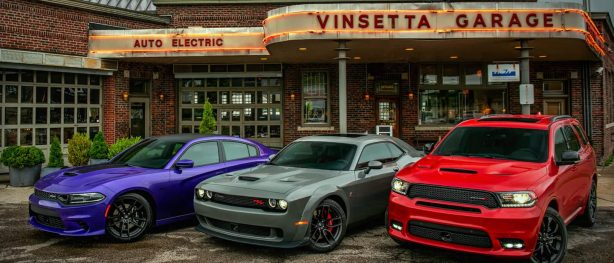 dodge challengers parked in front of vinsetta garage