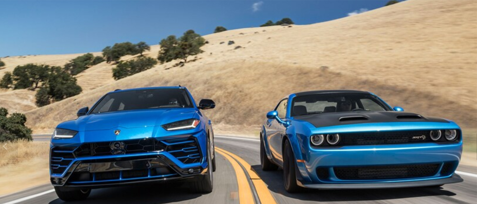 a Lamborghini Urus and a Dodge Challenger Hellcat Redeye driving side by side