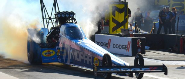 top fuel dragster doing a burnout