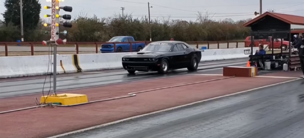 Challenger racing down the race track