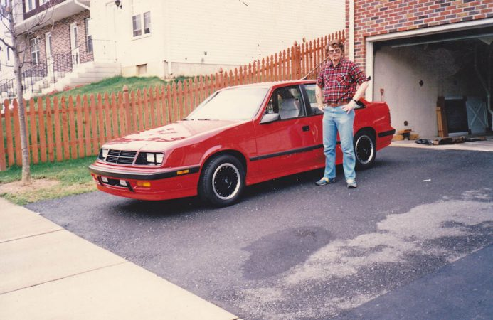 Man standing next to Shelby Lancer