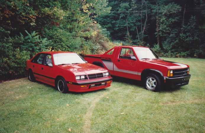 Shelby Lancer next to Dodge truck