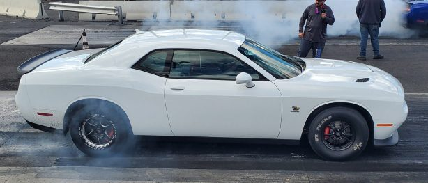 white challenger doing a burnout