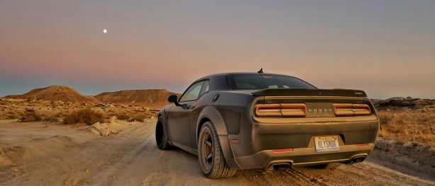 dirty Challenger SRT Demon on a dirt road