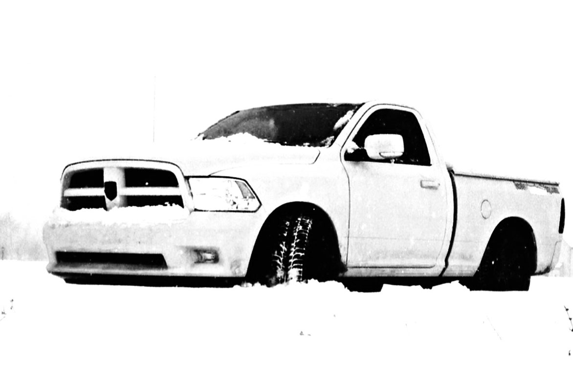 Dodge RAM parked in front of snow bank
