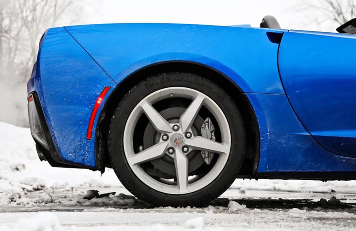 Blue convertible parked in snow