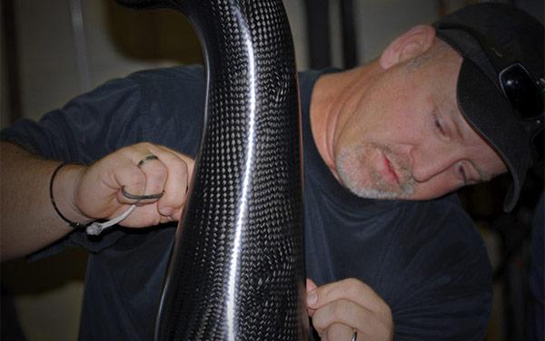 Chris Harrigan working on a vehicle