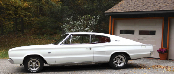 Driver side view of white 1966 Dodge Charger