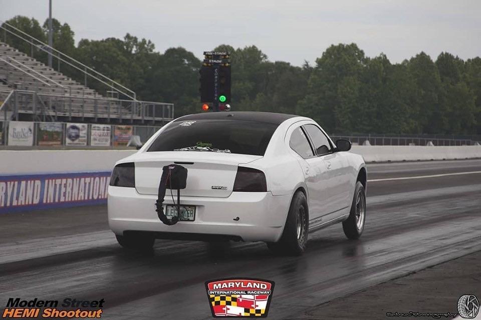 dodge vehicle racing on a drag strip