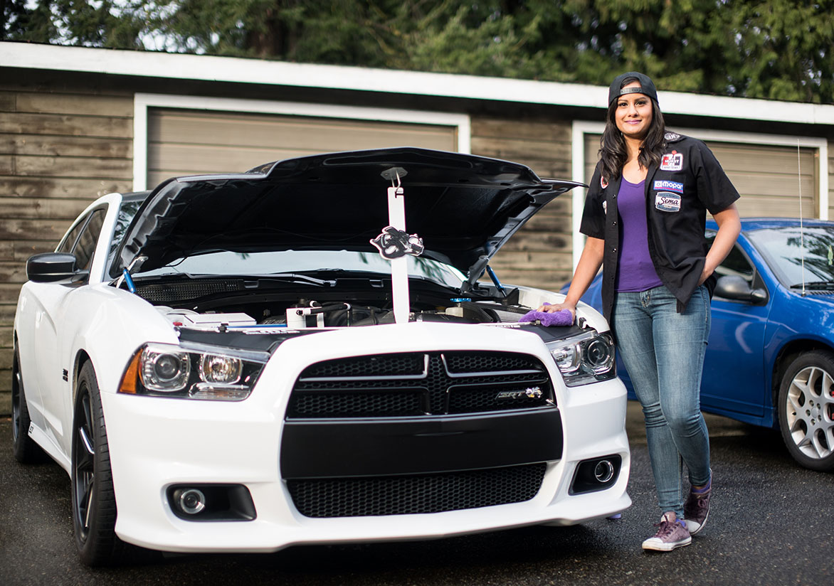 Jovita standing in front of her Dodge Charger Super Bee
