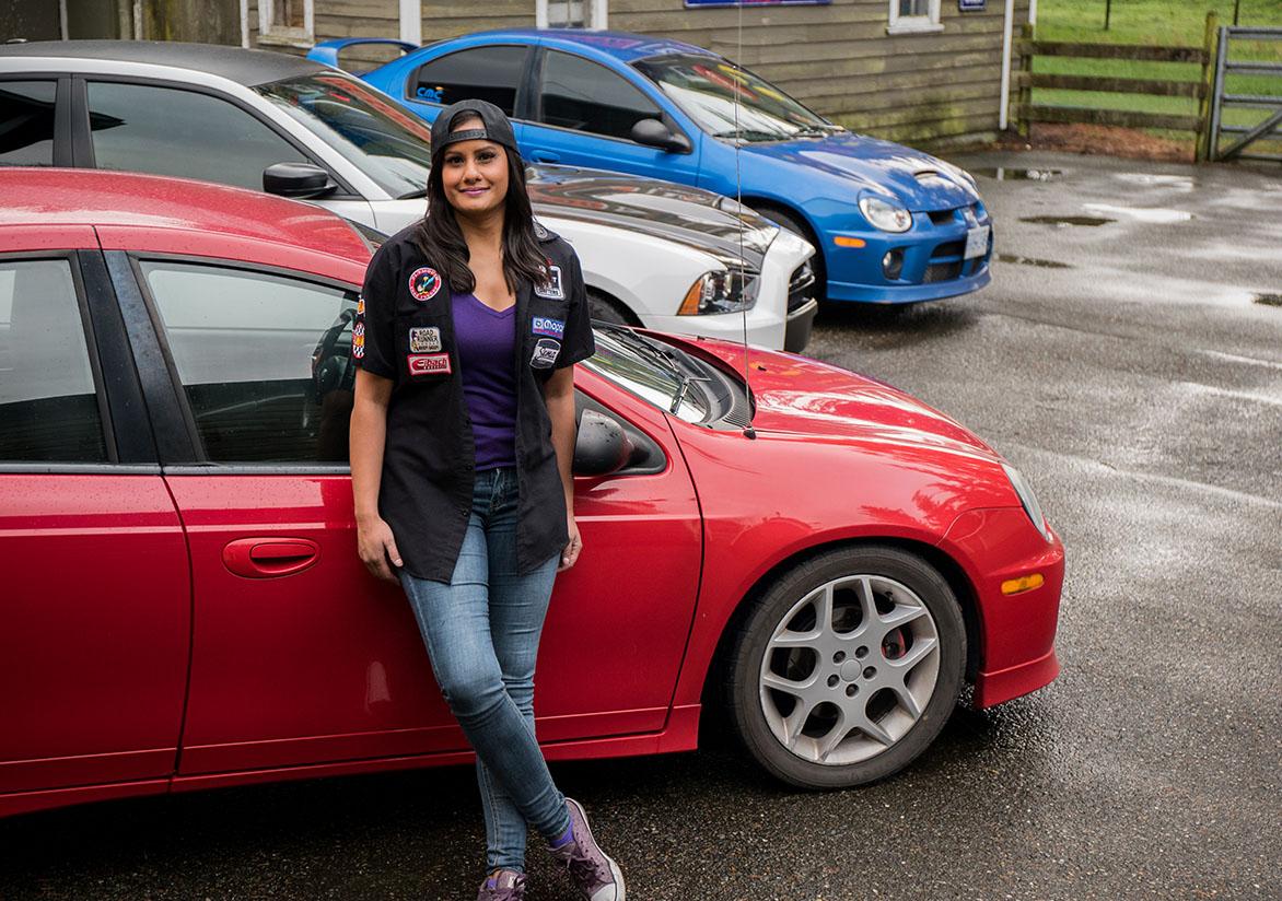 Jovita standing beside her red Dodge Neon