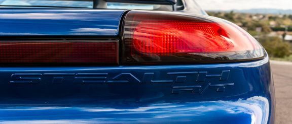 Tail light of blue Dodge Stealth