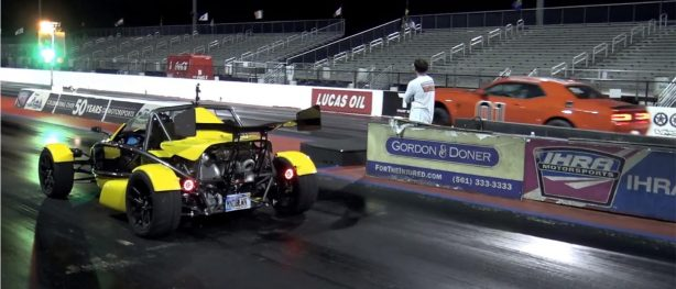 two vehicles on a drag strip