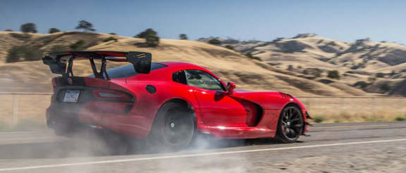 dodge viper driving down a road