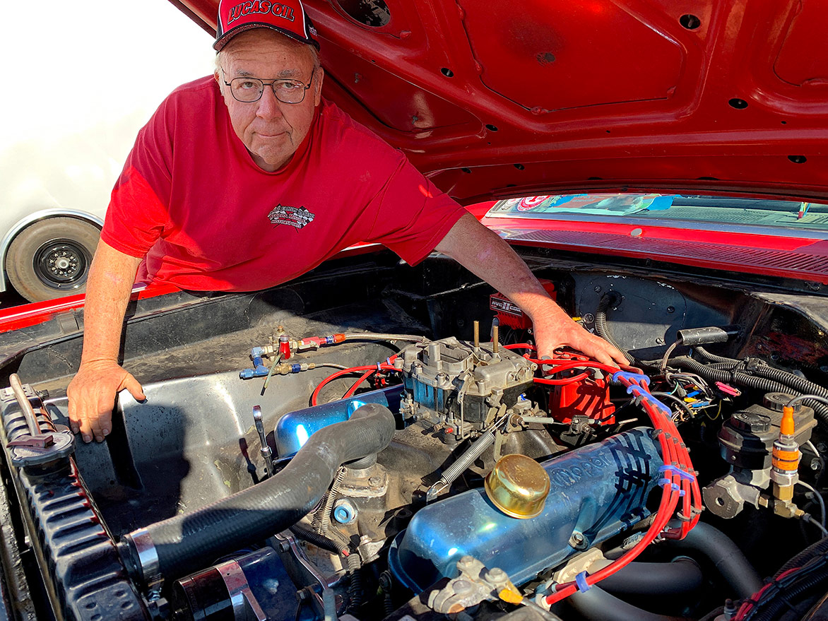 man with a car engine