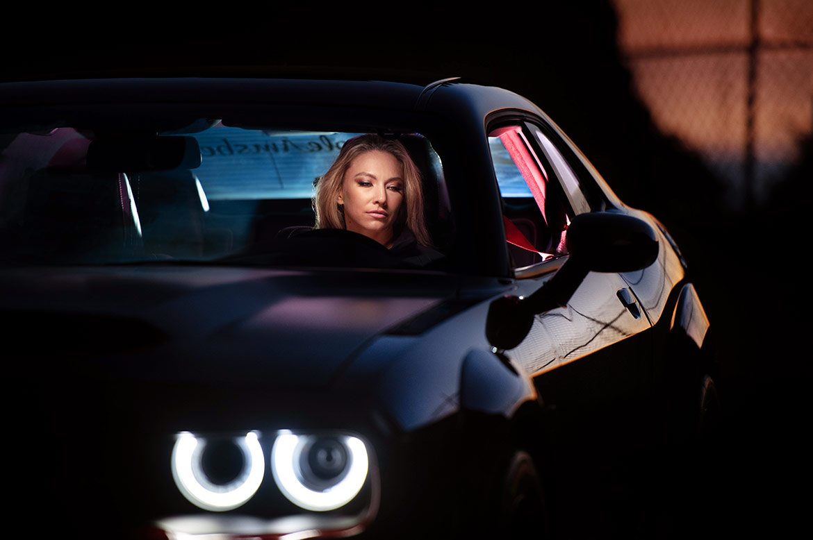 Woman in a dodge challenger